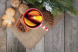 Christmas mulled wine with fir tree, gingerbread and spices