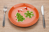 Christmas decor on plate and silverware