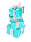 Three blue gift boxes with silver ribbon and bow