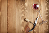 Red wine glass, corkscrew and wine cork