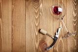 Red wine glass, corkscrew and wine cork