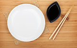 Empty plate, sushi chopsticks and soy sauce