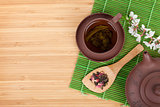 Japanese green tea and sakura branch over mat