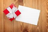 Red gift box over wooden background