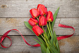 Fresh red tulips and ribbon
