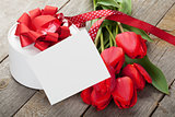 Fresh tulips, gift box and greeting card