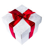 White gift box decorated with red ribbon on white background