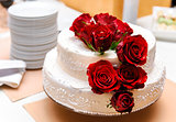 Wedding cake decorated with red roses