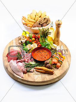 Abundance of raw food on a wooden board