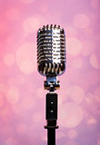 Professional vintage microphone over abstract background