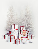 Adorable baby girl over christmas trees and heap of gift boxes