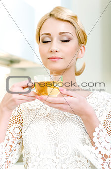 Portrait of beautiful girl drinking tea