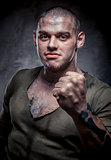 Portrait of young fighter with dirty face and chest