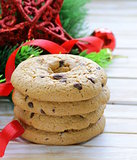 cookies with chocolate on a wooden background with Christmas tree branches and decorations