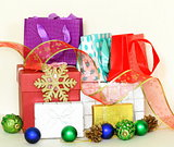 many gift boxes and colorful shopping bags with festive decorations