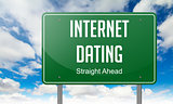 Internet Dating on Green Highway Signpost.