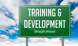 Training and Development on Highway Signpost.