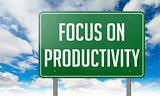 Focus on Productivity - Green Highway Signpost.