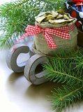 Christmas composition - wooden sleigh with gifts and fir tree branches
