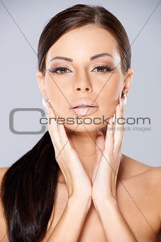 Portrait of young beautiful brunette girl