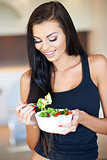 Young woman eating a healthy fresh salad