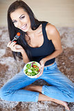 Healthy beautiful woman eating fresh salad