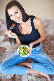 Healthy beautiful woman eating fresh salad