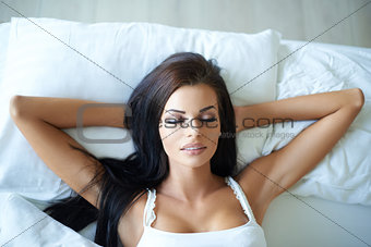 Attractive young woman having a lie in