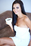 Beautiful woman relaxing with her morning coffee