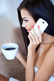Young woman listening to a mobile phone call