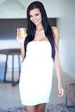 Young woman enjoying a glass of fresh orange