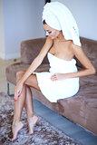 Woman Wearing Bath Towel Touching Her Leg