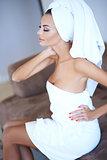 Woman Wearing Bath Towel with Hand on Hip