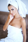 Woman Wearing Bath Towel with Hand Touching Face