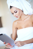 Woman wrapped in clean white towels