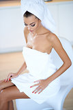 Woman Wearing White Bath Towel Sitting on Chair