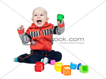 little boy with a plastic pyramid in the studio