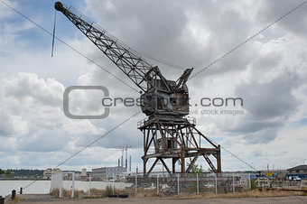 Forsaken crane on harbor