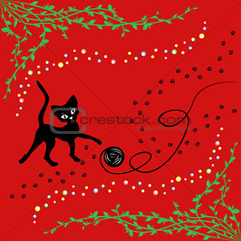 Black cat playing with ball of yarn