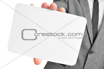 man in suit holding a blank signboard