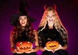 Halloween witches with pumpkins