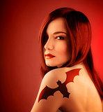 Girl with bat tatoo