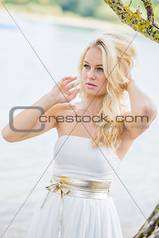 Blond woman under tree