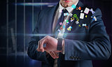 Composite image of businessman using hologram watch