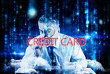 Credit card against lines of blue blurred letters falling