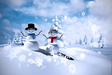 Composite image of snowman family