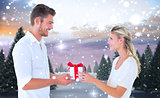 Composite image of young couple with gift