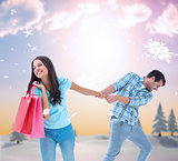 Composite image of happy couple with shopping bag