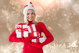 Composite image of happy festive blonde with gift