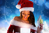 Composite image of sexy santa girl opening gift